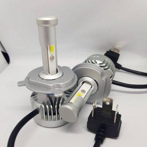 LED H4 N3 Citizen Professional Lighting - Оригинална LED система с Японско качество!  LED N3 Citizen Professional Lighting са Лед крушки от ново поколение за фарове с изключително качествена изработка и мощно осветяване. N3 серията има вградениCAMBUS модули, които със сигурност не дават грешките на бордовите компютри даже и на коли 2018 година! Крушката е изработена от Висококачествен Алуминии - Aviation Aluminum 6063 с Tитаниево покриетие, вентилаторно охлаждане и изключително качество на изработка! Готови за директен монтаж на автомобили, камиони, автобуси, мотори и селскостопанска техника без преправяне на инсталацията. Крушките са с CANBUS технология и не дават грешки на бордовите компютри. Директно се свързват към оригиналната букса, без допълнителни кабели, без баласти (запалки). Светлината от леда е много по-плътна, ярка, няма петна, по-дълъг обсег, няма го това забавяне,загряване и заслепяване както при ксенона!Имат мигновен старт. Една крушка LED 88 W се равняват на над 100 W ксенон! Сертификати за качество: RoHS, BCTC-14042020, IP67! Технически спецификации на Автомобилен LED Комплект N3 Citizen Professional Lighting H7 ТипLEDлампи:N3 Citizen Professional Lighting H4 LED 60W/10 000lm Предназначение: За фарове Употреба:Двойна светлина - Къси и дълги в една крушка Материал: Алуминий 6063, Титаниево покритие Чип:COB, разработен вUSA - 4 чипа Волтаж:Работен диапазон от 12Vдо 32V! Мощност:60W (2x30W) Светлина: Студено бяла Тегло (кг): 0.940 Цвят: 6000К (студено бяла) Излъчвана светлина: 2 x 5000LM = 10 000LM Работно напрежение:DC9V-32V Работна температура:-40◦C~ +80◦c Клас на защита:IP 65 Живот: до 120 000 часа Вид охлаждане: Вентилатор клас А++(японски) Производител:P.R.C Сертификати: CE, RoHS, IP65, Водоустойчиви!